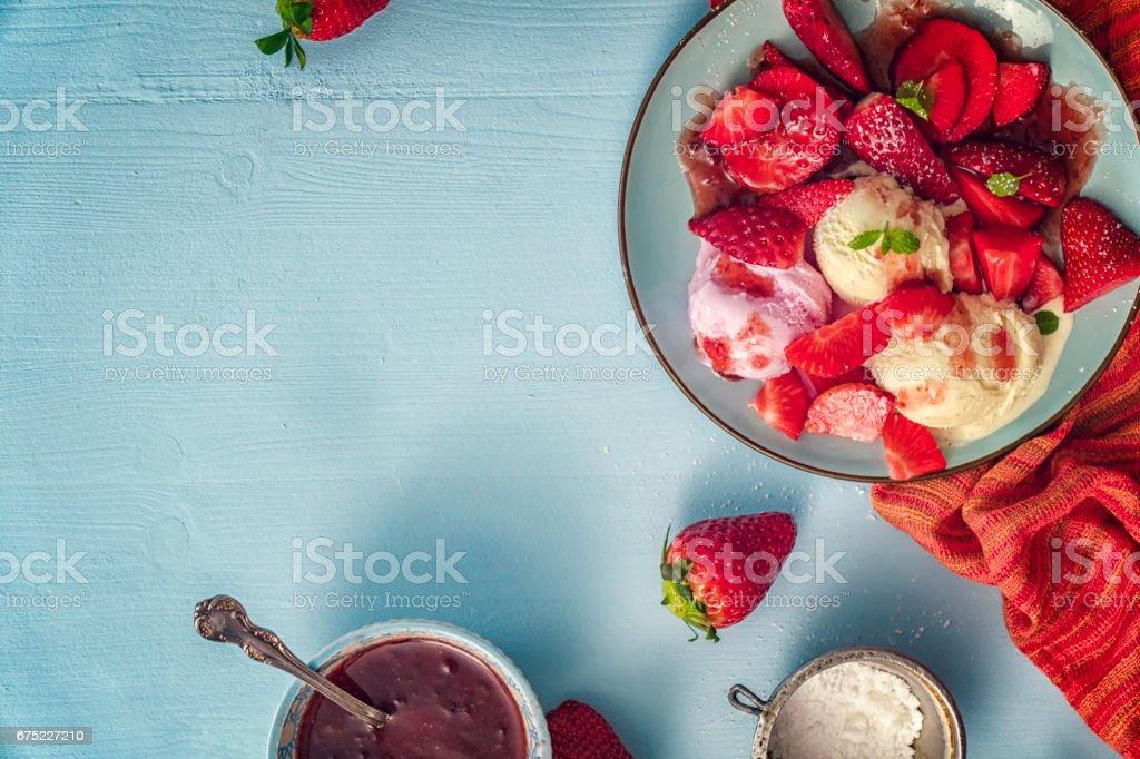 Homemade Vanilla Ice Cream with Fresh Strawberries royalty-free stock photo
