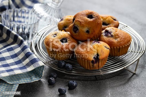 Closeup shots of muffins near blueberries.