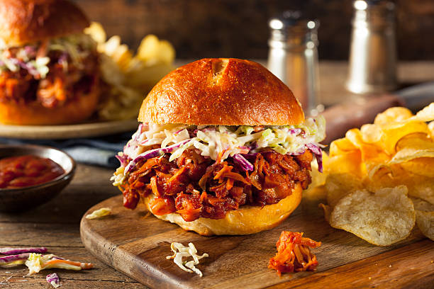 Homemade Vegan Pulled Jackfruit BBQ Sandwich Homemade Vegan Pulled Jackfruit BBQ Sandwich with Coleslaw and Chips slider burger stock pictures, royalty-free photos & images