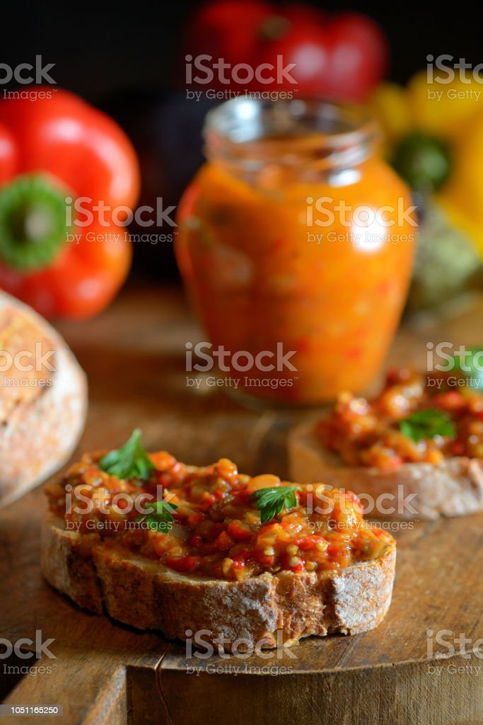 Homemade vegetable salad and bread on wooden table stock photo