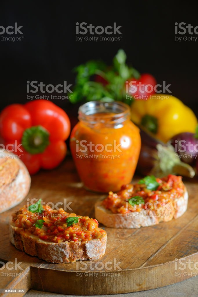 Homemade vegetable salad and slice of bread on wooden table stock photo