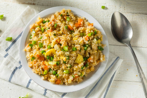 Homemade Vegetarian Fried Rice Homemade Vegetarian Fried Rice with Egg Peas and Carrots fried rice stock pictures, royalty-free photos & images