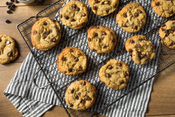 Homemade Warm Chocolate Chip Cookies Homemade Warm Chocolate Chip Cookies Ready to Eat chocolate chip cookie stock pictures, royalty-free photos & images