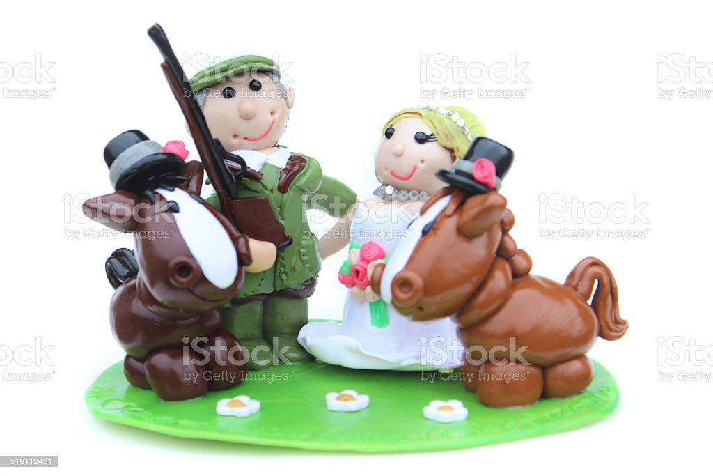 Homemade wedding cake topper (polymer-clay), country bride and groom, horses-shotgun stock photo