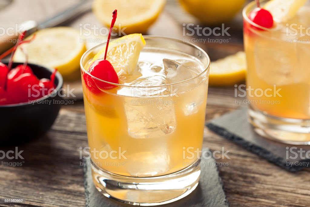 Homemade Whiskey Sour Cocktail Drink stock photo