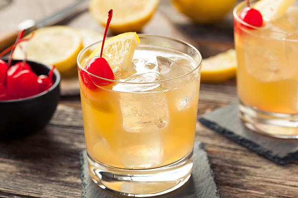Homemade Whiskey Sour Cocktail Drink Homemade Whiskey Sour Cocktail Drink with a Cherry Lemon brandy stock pictures, royalty-free photos & images