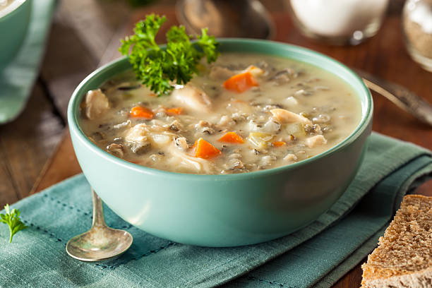 homemade wild rice and chicken soup - chicken rice stock photos and pictures