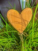 A homemade wooden heart for the decoration of plants