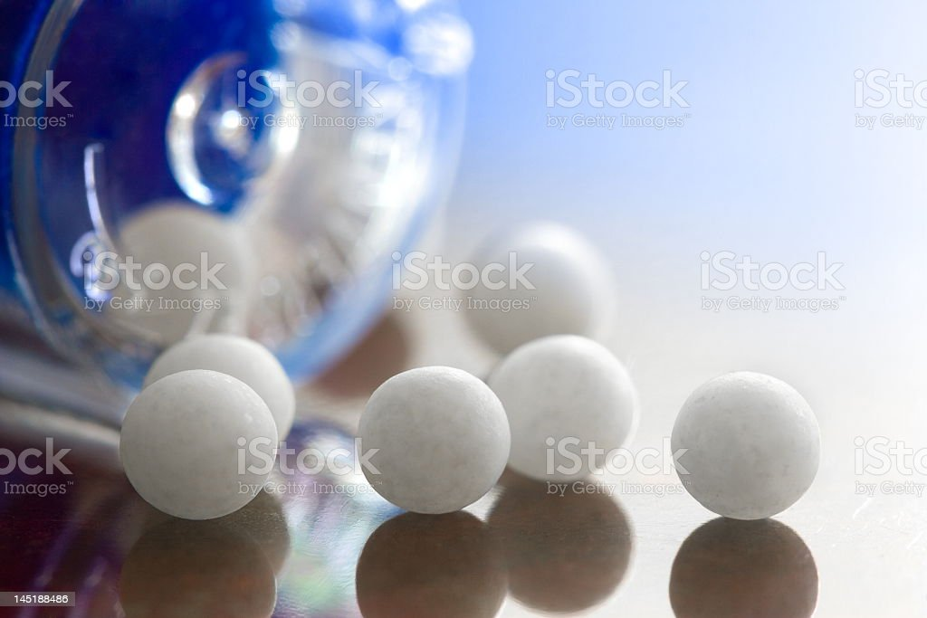 Homeopathic medication units on a table royalty-free stock photo