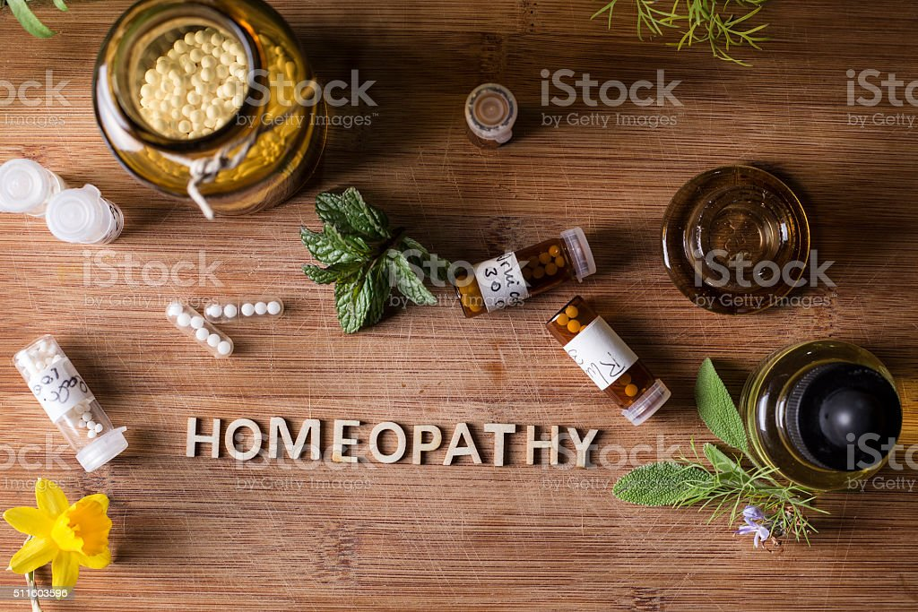 homeopathy globules and bottles stock photo