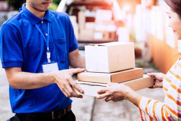 Homeowner woman receiving package. stock photo