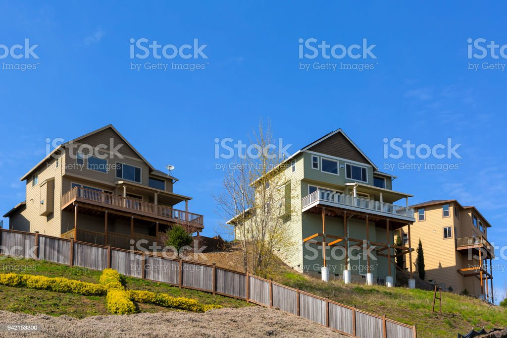 Homes In North American Suburban Neighborhood On Stilts Along Hillside Lots  Royalty Free Stock Photo