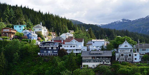 Homes Overlooking Ketchikan Harbor Many homes sit high on a ridge with a waterfront view of the port of Ketchikan in Alaska ketchikan stock pictures, royalty-free photos & images