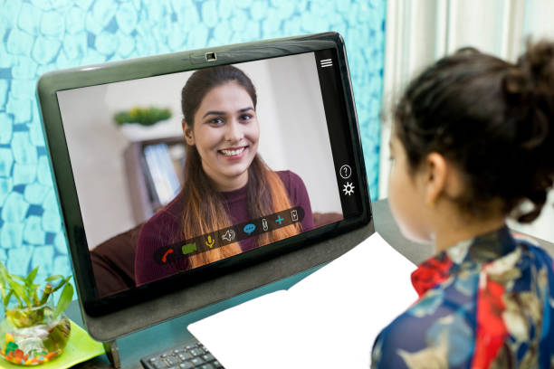 Homeschooling distance learning at home with teacher teaching remotely stock photo