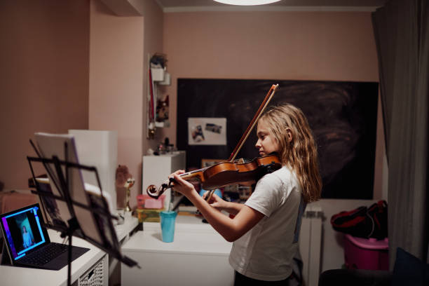 Homeschooling Online Violin Classes stock photo