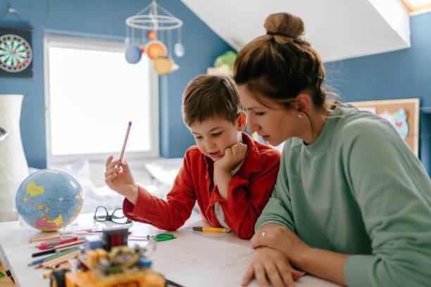 hemundervisning - förälder bildbanksfoton och bilder