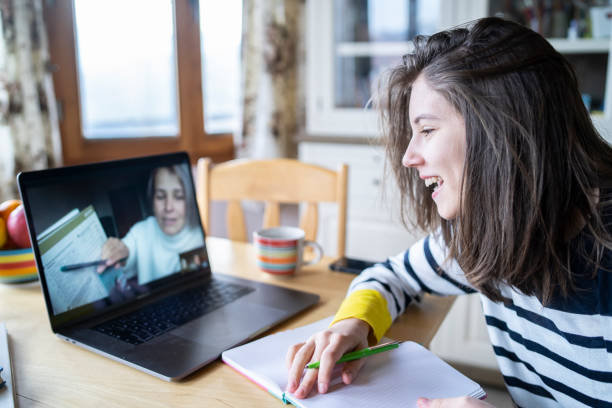 Homeschooling Educational teleconference during coronavirus pandemic high school teacher stock pictures, royalty-free photos & images