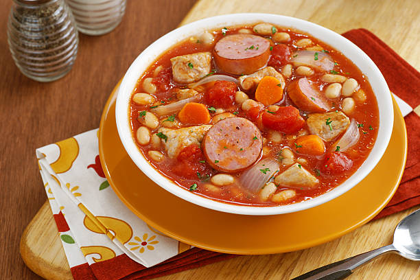 Homestyle Cassoulet Soup Homestyle Cassoulet soup with great northern beans and kielbasa sausage. ragout stock pictures, royalty-free photos & images