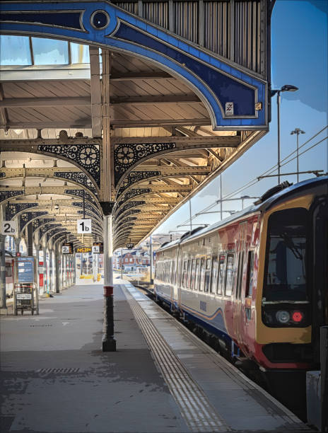 Homeward Bound Train sitting in station ready to depart empty platform electric train stock pictures, royalty-free photos & images