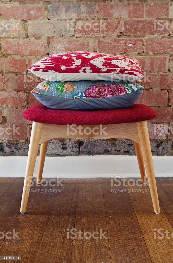 Homewares cushions on ottoman stool stock photo