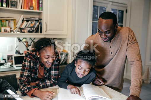 Siblings and dad with homework