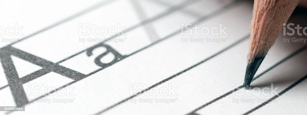 Homework. Learning concept. Learning the alphabet. handwriting skills Close up. stock photo