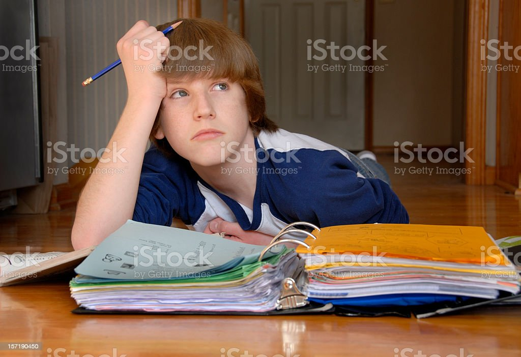Homework on the Floor stock photo
