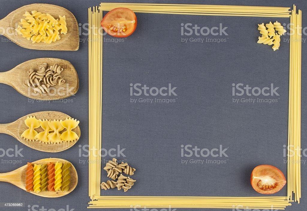 Homework pasta, creating the menu, spoons with pasta and spaghetti stock photo