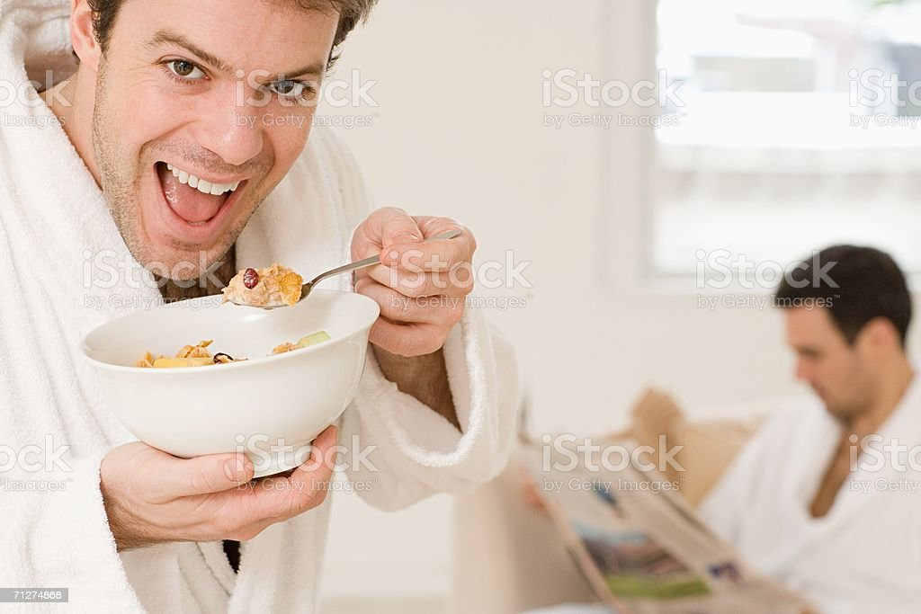 Homosexual couple eating breakfast royalty-free stock photo