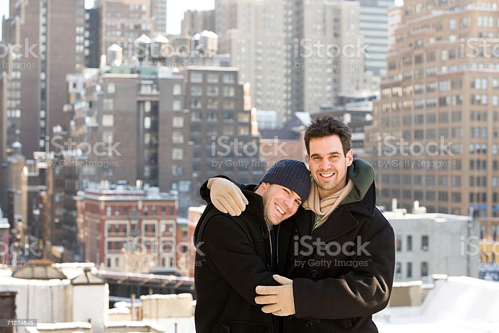 Homosexual couple embracing stock photo