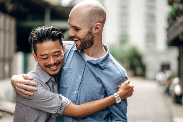 Homosexual couple in city stock photo