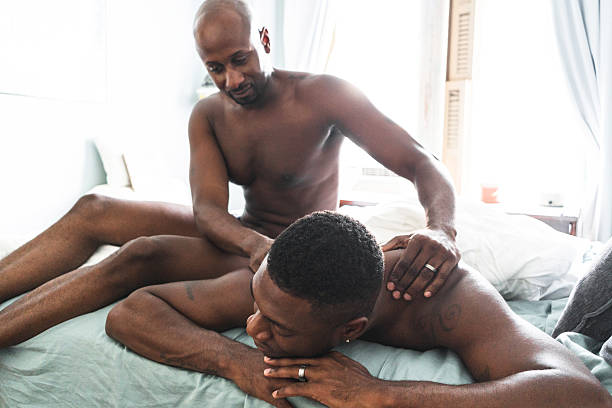 homosexual couple relaxing togetherness and sharing a massage stock photo