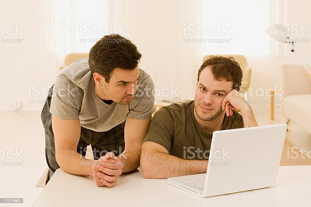 Homosexual couple using laptop royalty-free stock photo
