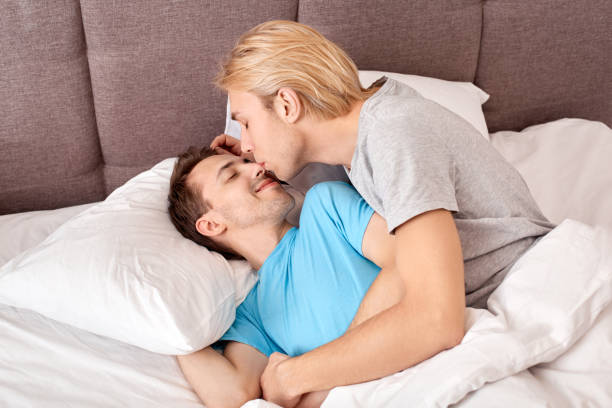 Homosexual relationship gay couple lying on bed at home man waking up picture id1219641802?b=1&k=6&m=1219641802&s=612x612&w=0&h=w0zjegsfh6xgykcmqpdmwgg1jmydv7ityp9hy hraug=