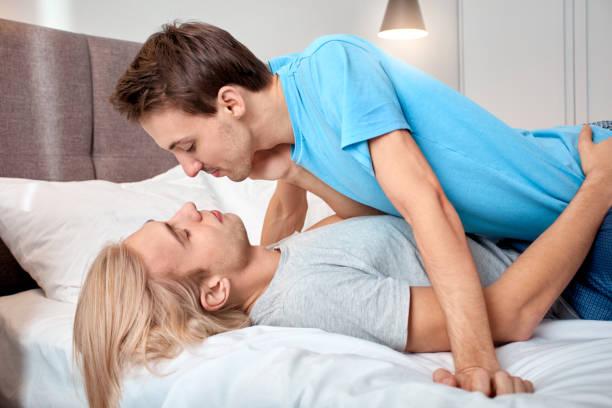 Homosexual relationship gay couple man lying on boyfriend on bed at picture id1219641803?b=1&k=6&m=1219641803&s=612x612&w=0&h=2rg9tdrnnarts5e5hjzxj5mphojywatyniodp20sfjy=