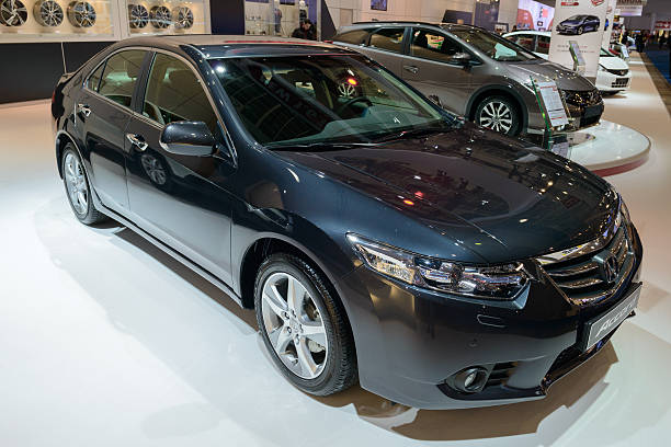 Honda Accord Saloon Brussels, Belgium - January 14, 2014: Honda Accord Saloon Sedan family car on display at the 2014 Brussels motor show. People in the background are talking. 2014 stock pictures, royalty-free photos & images