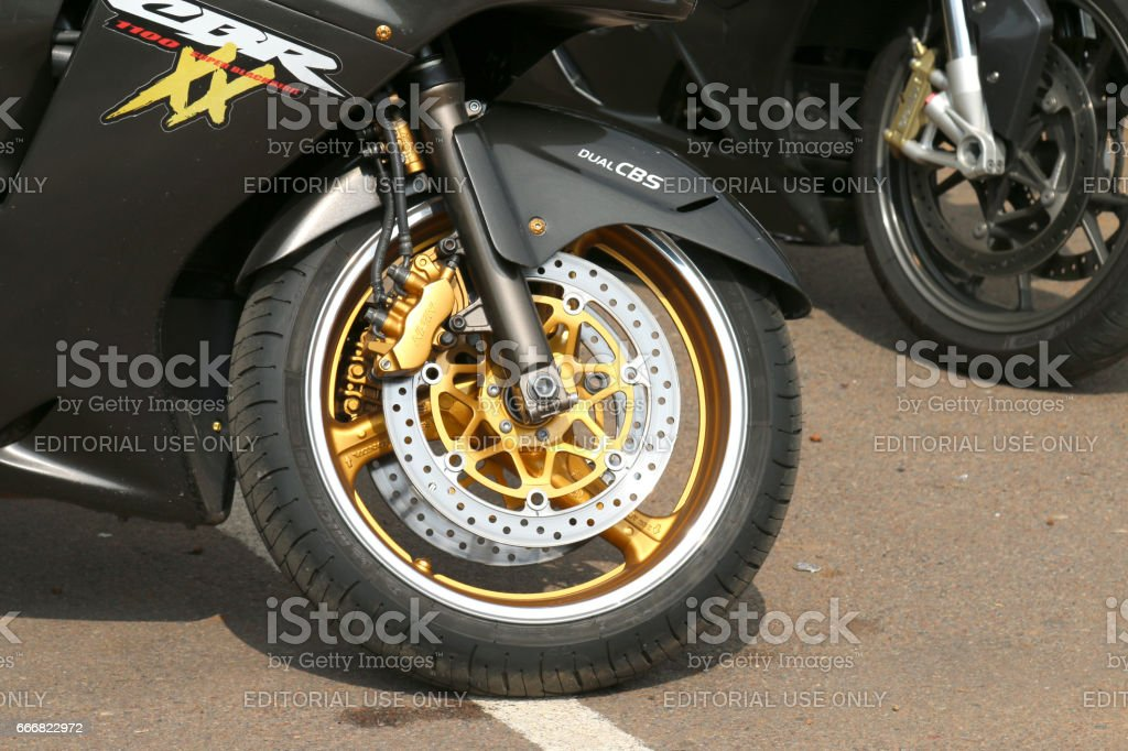 Honda CBRXX front tyre with silver and gold colors stock photo