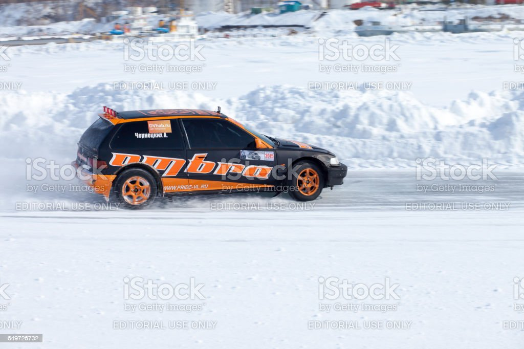 Honda civic at winter ice track race on frozen river stock photo