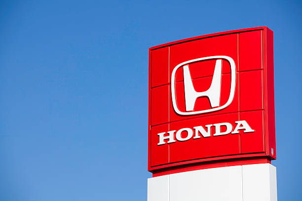 Honda Sign at Car Dealership Dartmouth, Nova Scotia, Canada - March 13, 2011: A Honda Motor Company, Ltd. sign at a car dealership.  Founded in 1948 Honda Motor Company, Ltd. is best known for manufacturing automobiles and motorcycles. vehicle brand name stock pictures, royalty-free photos & images