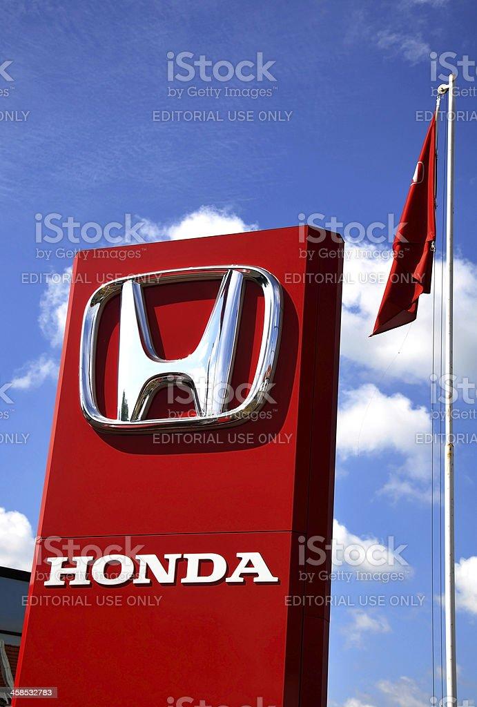 Honda sign next to a car trading royalty-free stock photo