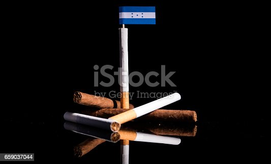istock Honduran flag with cigarettes and cigars. Tobacco Industry concept. 659037044