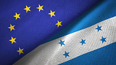 Honduras and European Union two flags together textile cloth, fabric texture