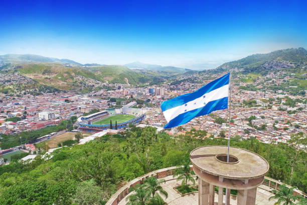Honduras flag in Tegucigalpa A droone photo from Cerro Juana Lainez with Honduras flag and the city of Tegucigalpa honduras stock pictures, royalty-free photos & images