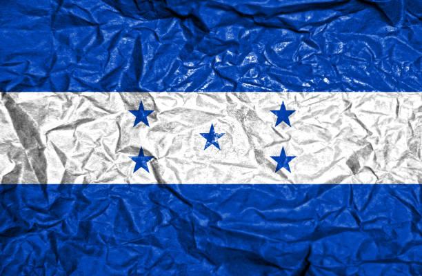 bandera vintage honduras en viejo fondo de papel arrugado - bandera de honduras fotografías e imágenes de stock