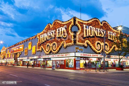Toronto, Canada - July 30, 2014: The outside of Honest Eds at night in Toronto. People can be seen outside.