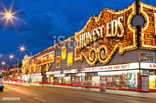 Toronto, Canada - July 30, 2014: The outside of the Honest Eds Store at night in Toronto. People can be seen outside the building.