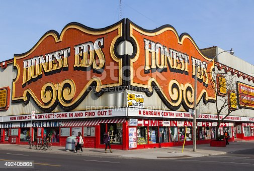 Toronto, Canada- 13th May 2014: The outside of the Honest EDS Department Store along Bloor Street during the day. People and traffic can be seen outside the building.