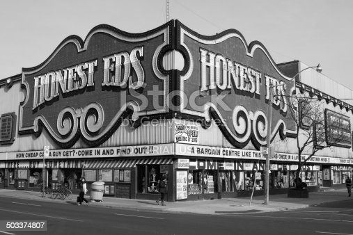 Toronto, Canada - May 13, 2014: The outside of the Honest EDS Department Store along Bloor Street during the day. People can be seen on the street.