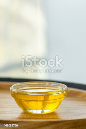 honey, a small portion (a sweet treat in a small portion plate)