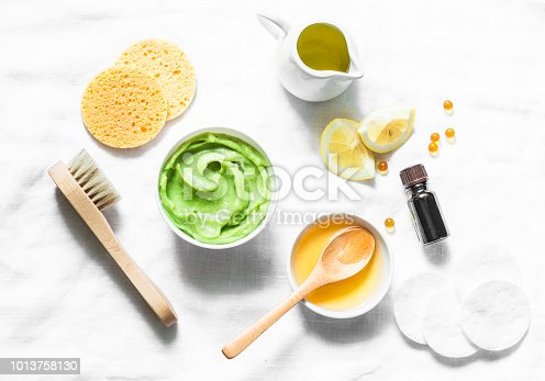 istock Honey and avocado face mask on light background, top view. Beauty, youth, skin care concept. Flat lay 1013758130
